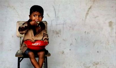 A young boy eats his lunch