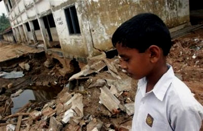 A young boy walks amid the destruction