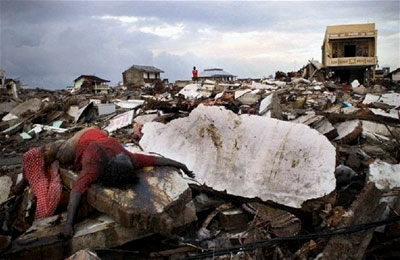 A dead womain amid the rubble of Banda Aceh, Indonesia