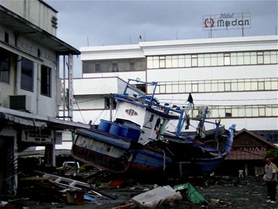 A destroyed boat that was thrown on land by the tsunami