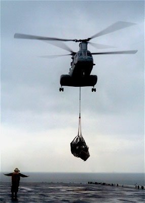 A U.S. Navy helicopter on an aid mission