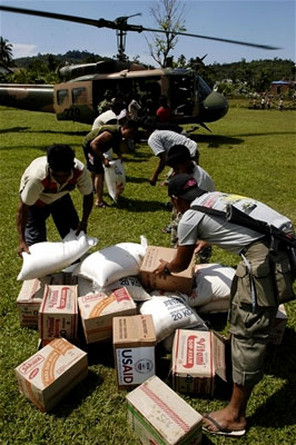 Villagers receive aid from the U.S. Navy
