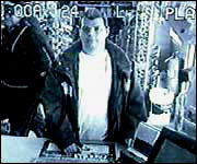 Timothy Barnes is caught on surveillance cameras stealing tsunami donation cans