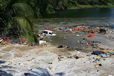 Tsunami Pictures: #4 - A car is swept away by the tsunami in Thailand