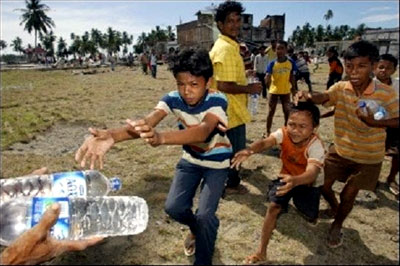 Children run to get some bottles of water